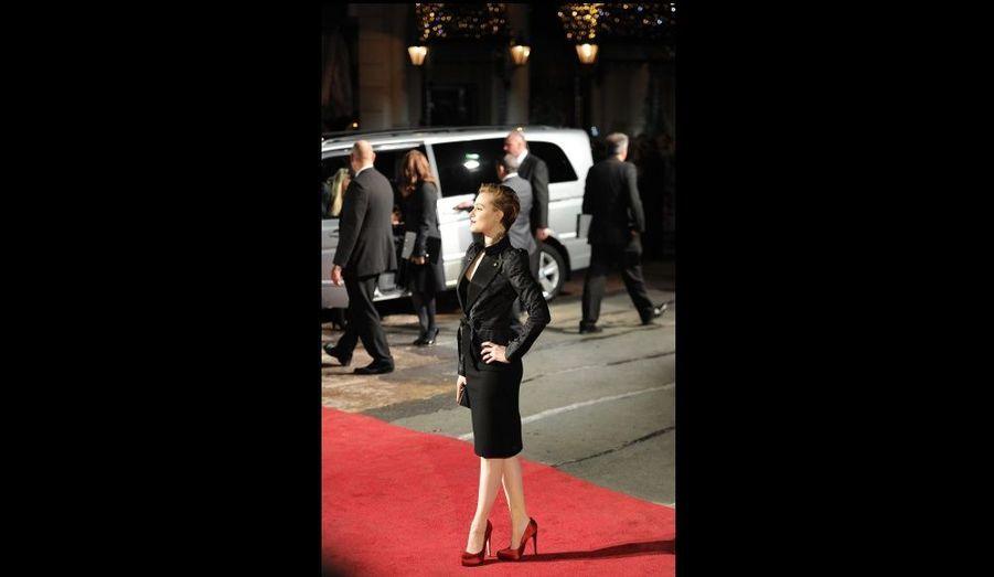 L'actrice Evan Rachel Wood pose avant la projection du film Les Marches du pouvoir à Leicester Square, à Londres.