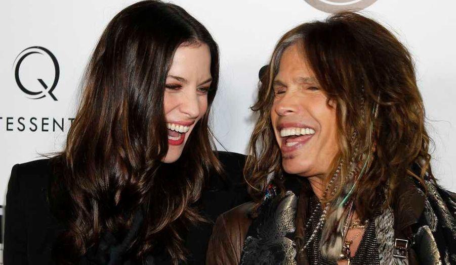 Liv Tyler et son père, le chanteur d'Aerosmith, Steven Tyler, à la première du film Super, de James Gunn à Hollywood.