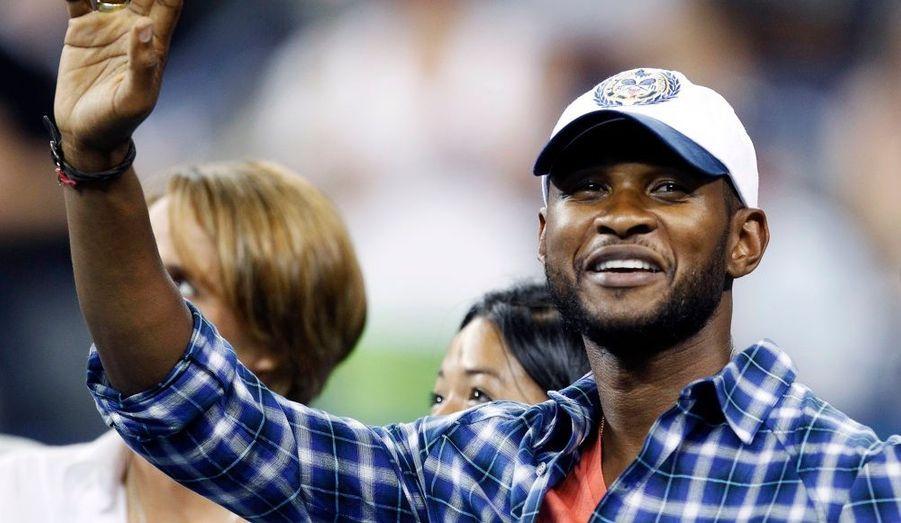 Le chanteur Usher était hier à New York pour assister à des matches du tournoi de l'U.S. Open.