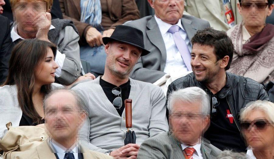 Patrick Bruel et l'ancien joueur de football français Franck Leboeuf ont assisté à un match à Roland Garros mardi.