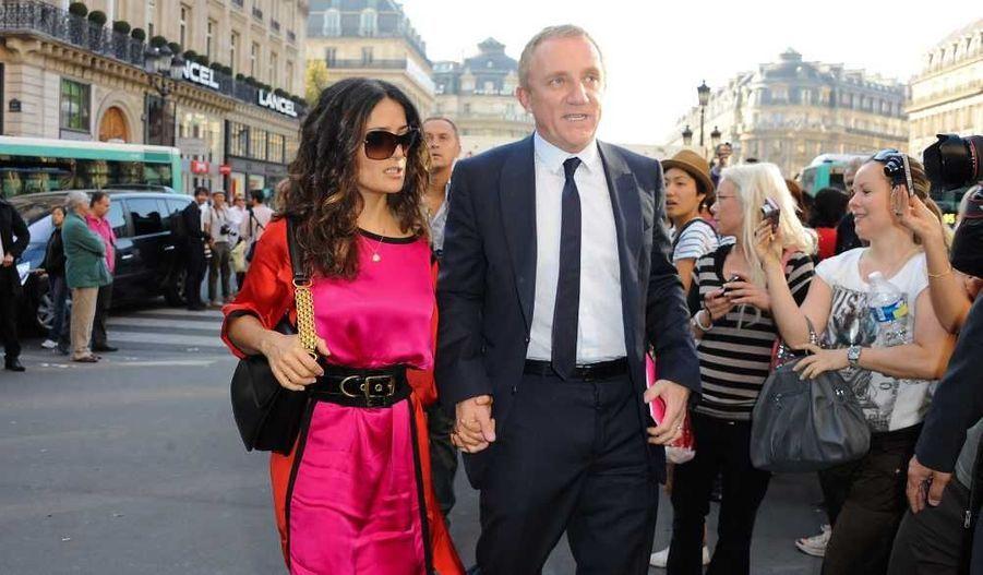 L'arrivé remarquée de Salma Hayek et son mari Francois-Henri Pinault au défilé de prêt-à-porter Stella McCartney Pintemps-Ete 2012 ce lundi à l'Opéra Garnier de Paris.