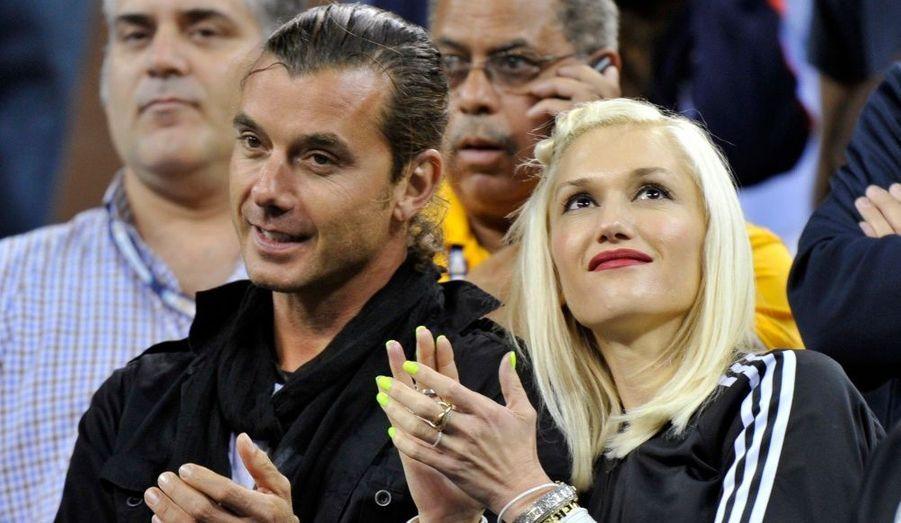 La chanteuse Gwen Stefani et son mari Gavin Rossdale applaudissent la victoire du tennisman Roger Federer contre Jurgen Melzer à l'US Open, hier.