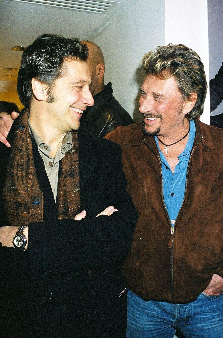 Johnny Hallyday et Laurent Gerra en 2004.