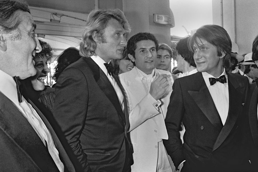 Johnny Hallyday et Jacques Dutronc (avec Claude Lelouch et Lino Ventura) à Cannes en 1979.