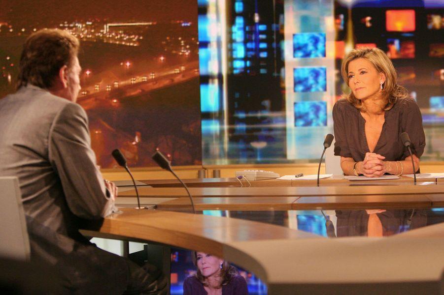 Claire Chazal face à Johnny Hallyday pendant le 20heures de TF1 en 2009