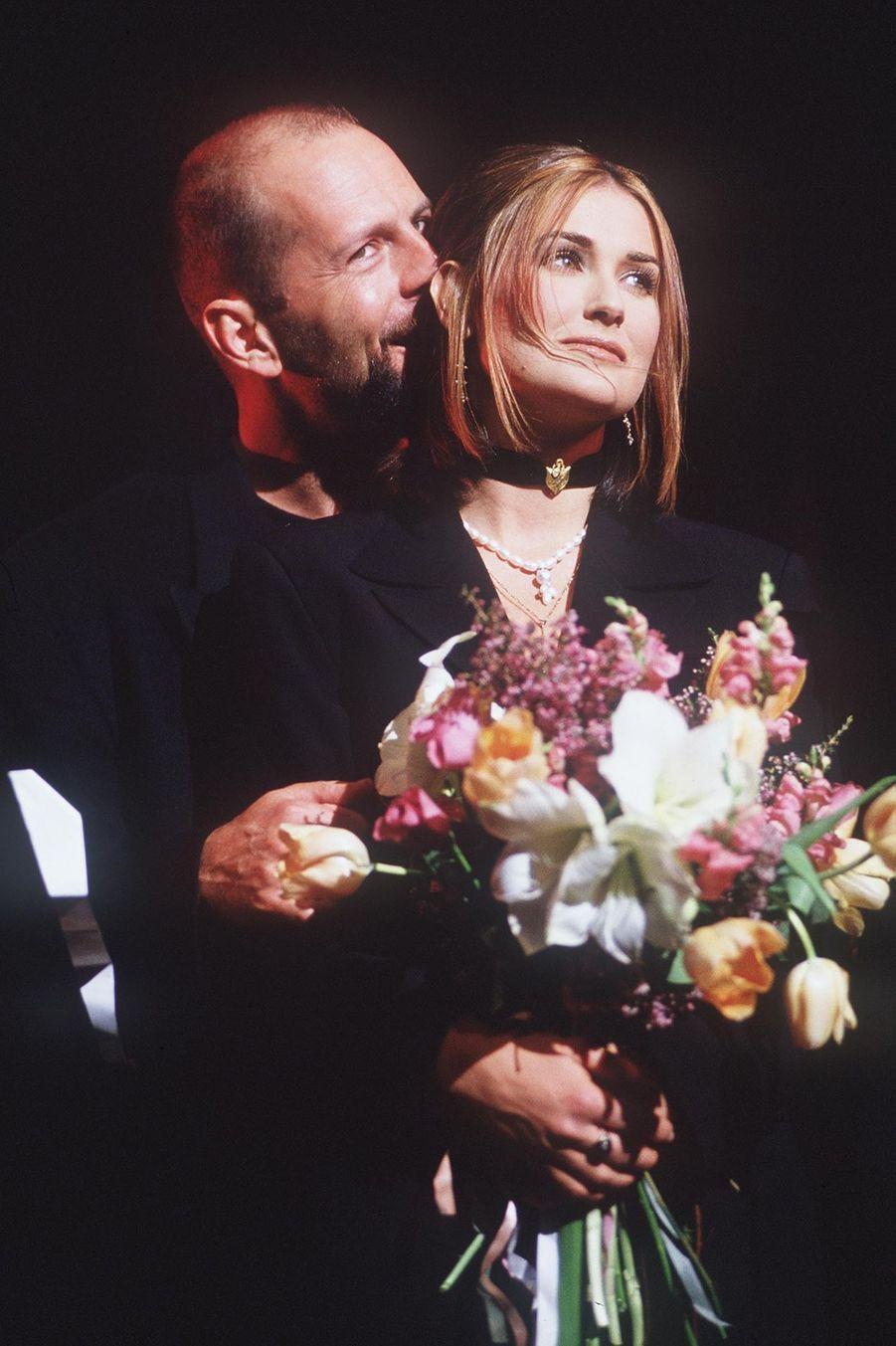 """Bruce Willis et Demi Moore au concert caritatif """"City Kids"""", le 16 janvier 1993."""