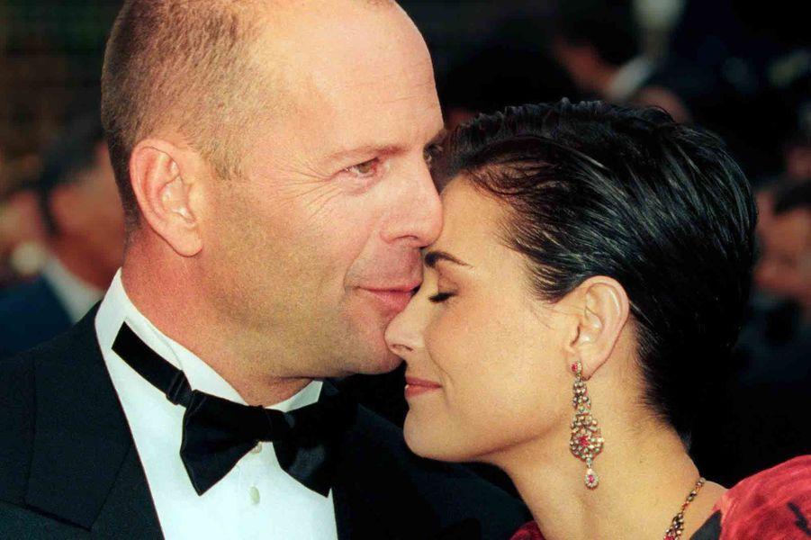 """Bruce Willis et Demi Moore à la première du film """"Le Cinquième Élément"""" à Cannes, le 7 mai 1997."""