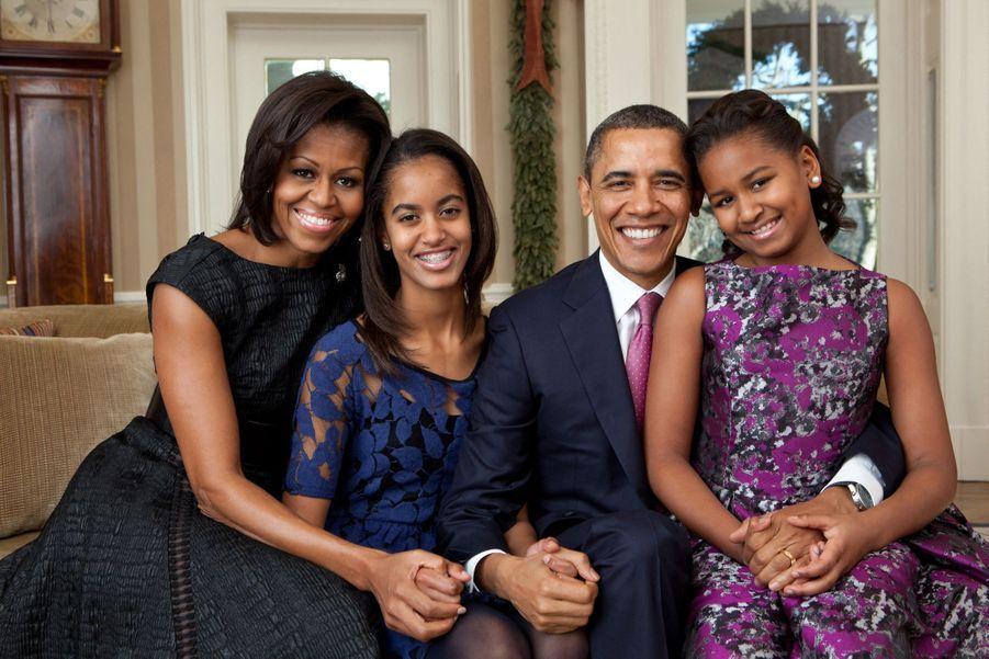 Barack et Michelle Obama avec leurs filles Malia et Sasha à Washington, le 11 décembre 2011