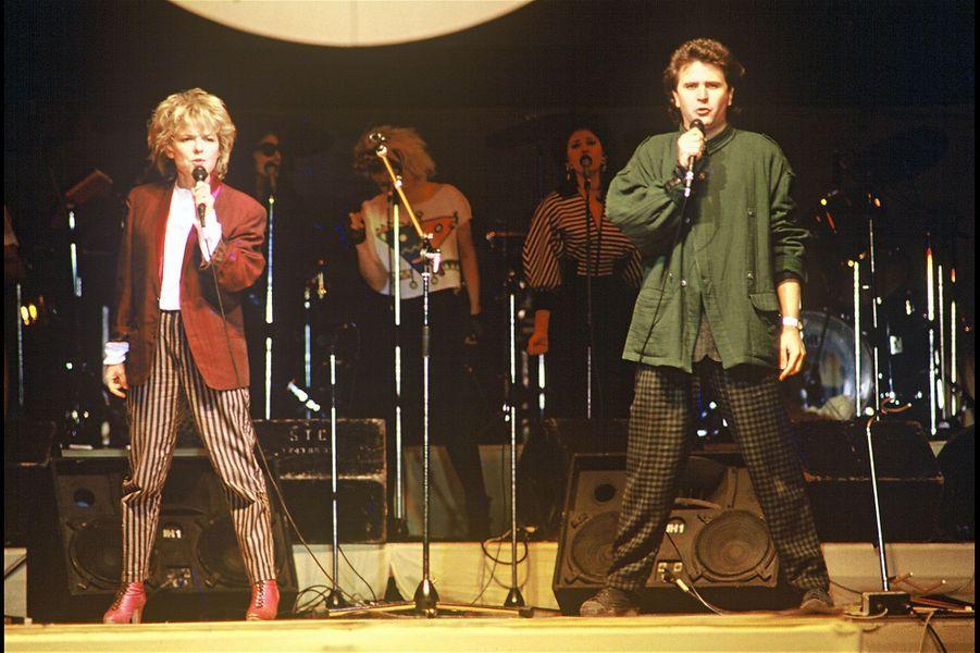 """France Gall et Michel Berger sur scène en 1985 lors du concert """"Concerts sans frontières"""""""