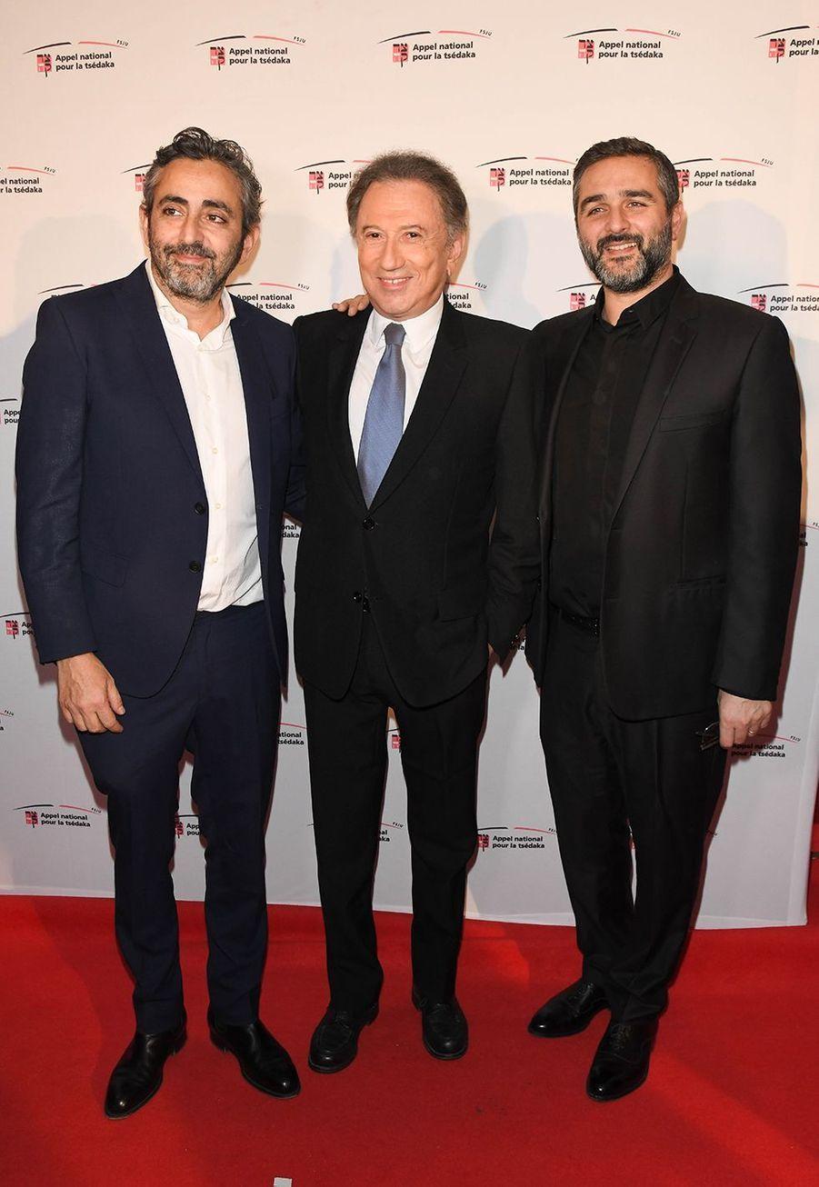 Eric Toledano, Michel Drucker et Olivier Nakachelors de la soirée caritative des parrains de l'Appel national pour la Tsedaka à Paris le 1er décembre 2019.
