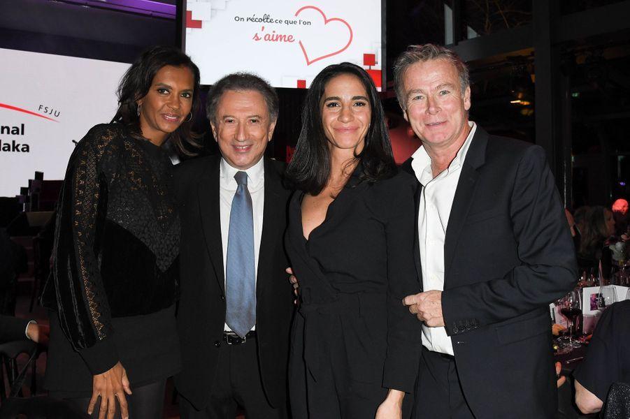 Karine Le Marchand, Michel Drucker, Franck Dubosc et sa femme Danièle lors de la soirée caritative des parrains de l'Appel national pour la Tsedaka à Paris le 1er décembre 2019.