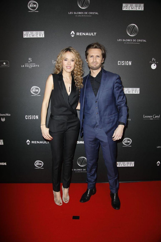 Elodie Fontan et Philippe Lacheausur le tapis rouge de la 14e édition des Globes de Cristal à Paris le 4 février 2019
