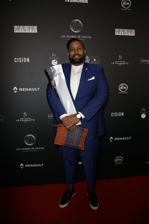 Kevin Razysur le tapis rouge de la 14e édition des Globes de Cristal à Paris le 4 février 2019