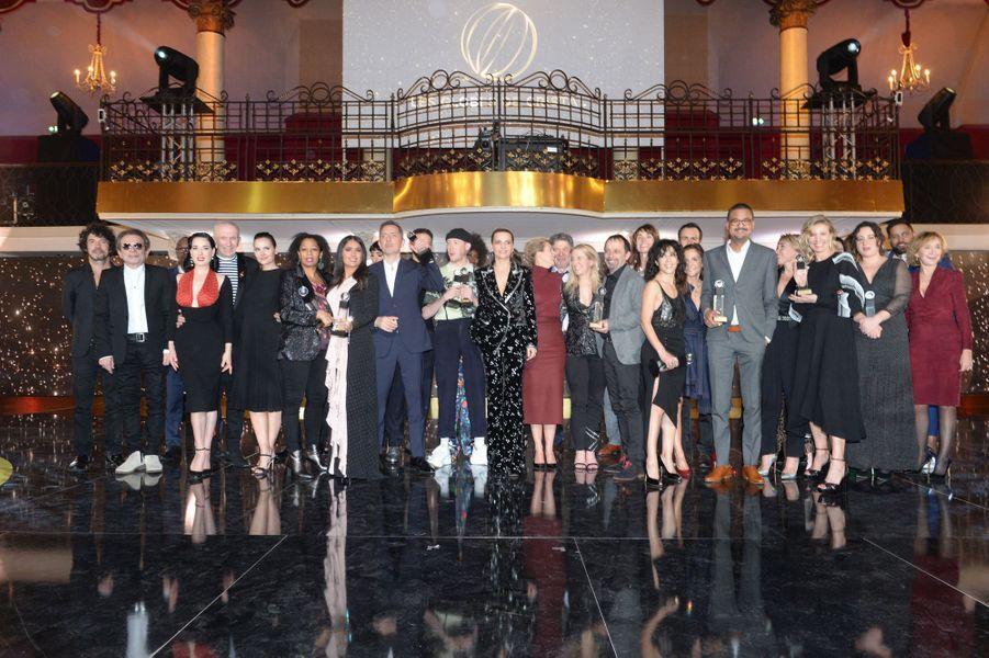 Les lauréats de la 14e cérémonie des Globes de Cristal réunis sur la scène de la Salle Wagram à Paris le 4 février 2019