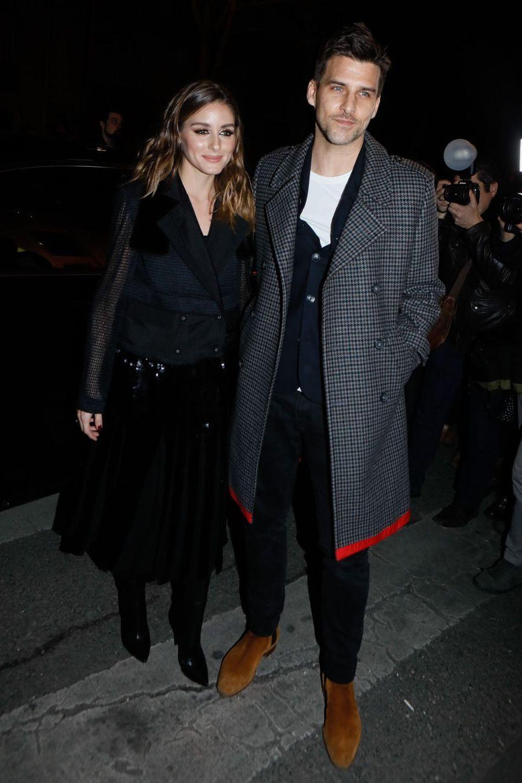 Olivia Palermo et son mari Johannes Huebllors du défilé Tommy Hilfiger à Paris, le 2 mars 2019