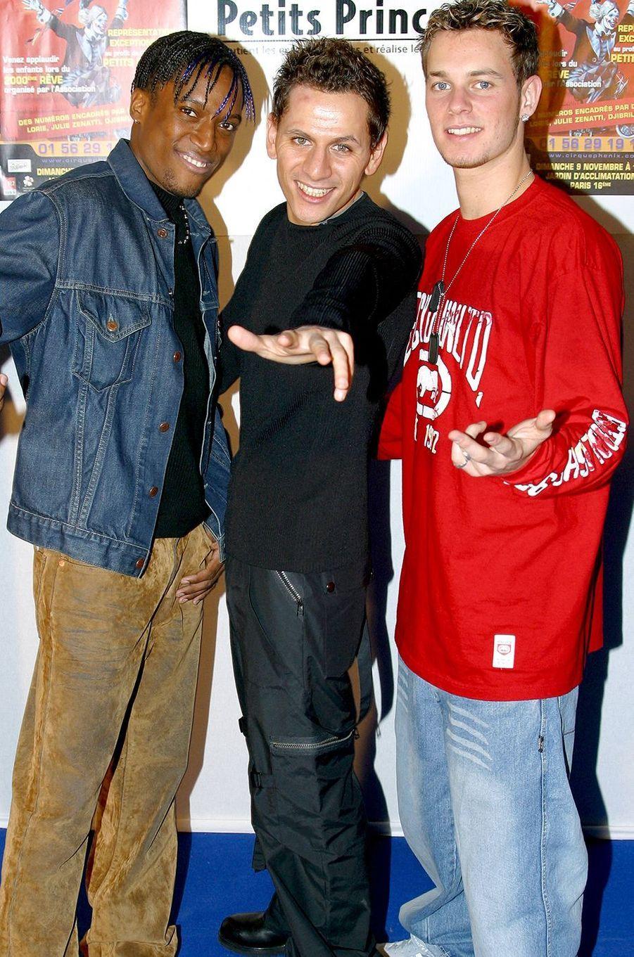 Otis Guilon, Lionel Tim et Matt Pokora du groupe Linkup en 2003 lors d'un événement pour l'association Les Petits Princes à Paris