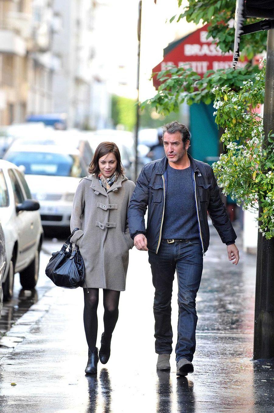 Jean Dujardin et Nathalie Péchalat, leur histoire d'amour en images.