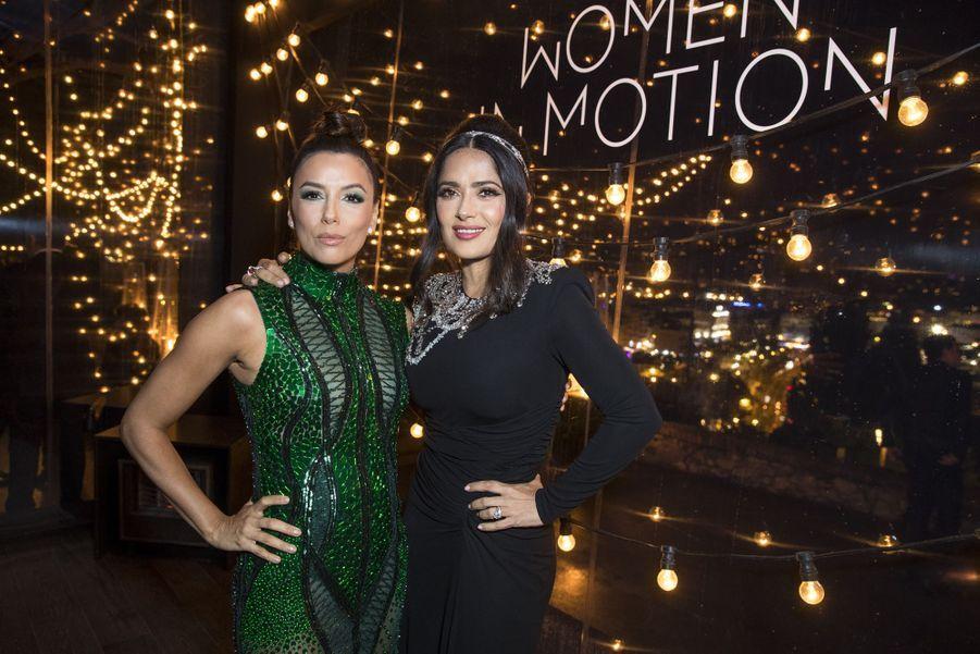 Eva Longoria et Salma Hayekà la soirée Kering «Women In Motion Awards» lors du 72ème Festival International du Film de Cannes le 19 mai 2019