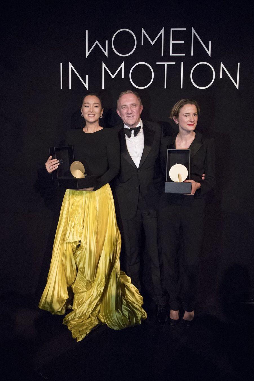 Gong Li, François-Henri Pinault et Eva Trobischà la soirée Kering «Women In Motion Awards» lors du 72ème Festival International du Film de Cannes le 19 mai 2019
