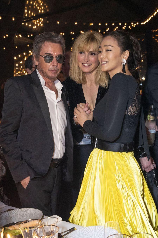 Jean-Michel Jarre, Julie Gayet et Gong Lià la soirée Kering «Women In Motion Awards» lors du 72ème Festival International du Film de Cannes le 19 mai 2019