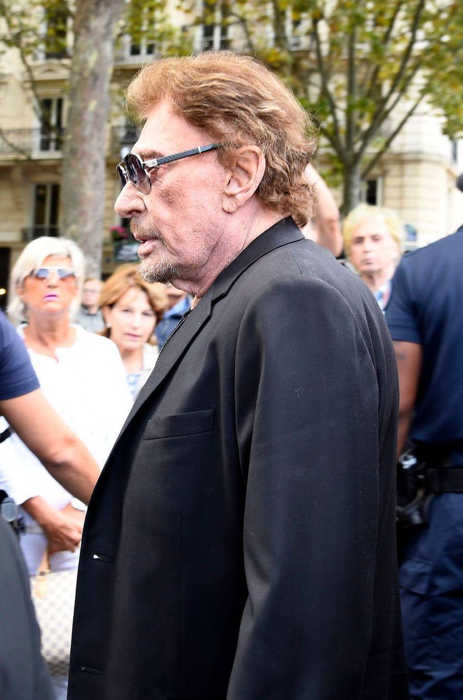 Johnny Hallydayaux funérailles de Mireille Darc à Paris, le 1er septembre 2017.