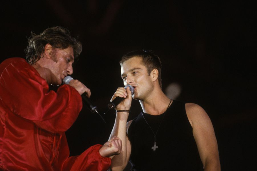 Johnny Hallyday et David partagent la scène du Parc des princes en 1993.