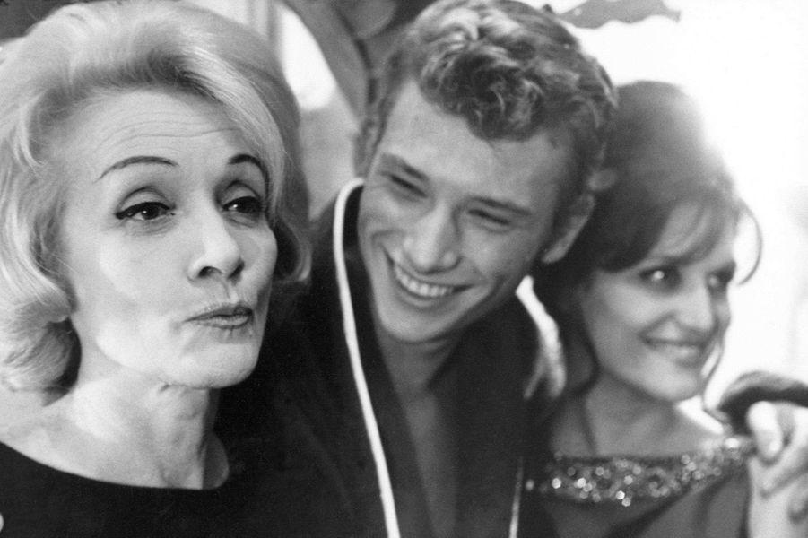 Johnny Hallyday avec Marlène Dietrich et Dalida en 1965.