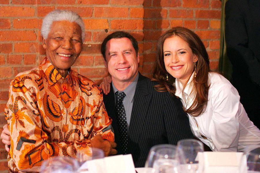 Nelson Mandela, John Travolta et Kelly Preston, en mai 2005.