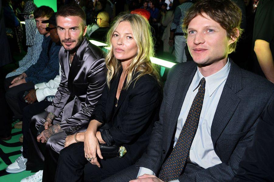David Beckham, Kate Moss et son compagnon Nikolai Von Bismarckassistent au défilé automne-hiver 2020 Dior à Miami le 3 décembre 2019.