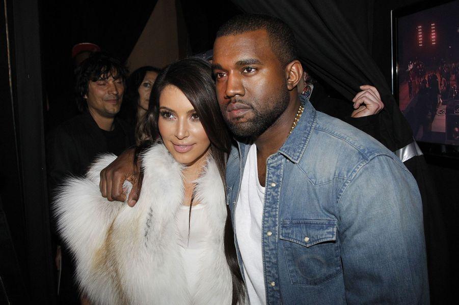 Kim Kardashian et Kanye West à Paris lors de la Fashion Week en mars 2012