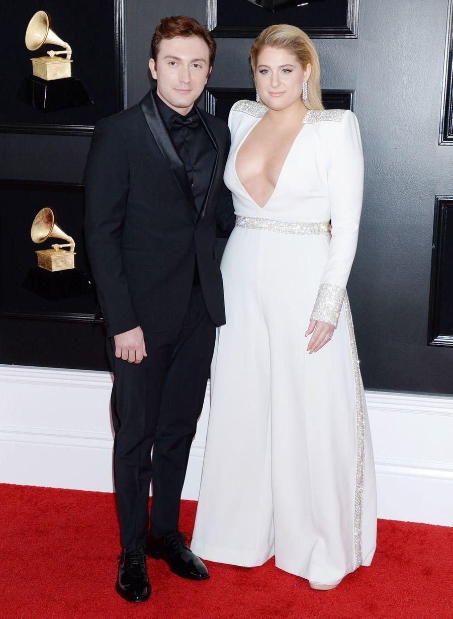 Meghan Trainor et son mari Daryl Sabarasur le tapis rouge des Grammy Awards à Los Angeles le 9 février 2019