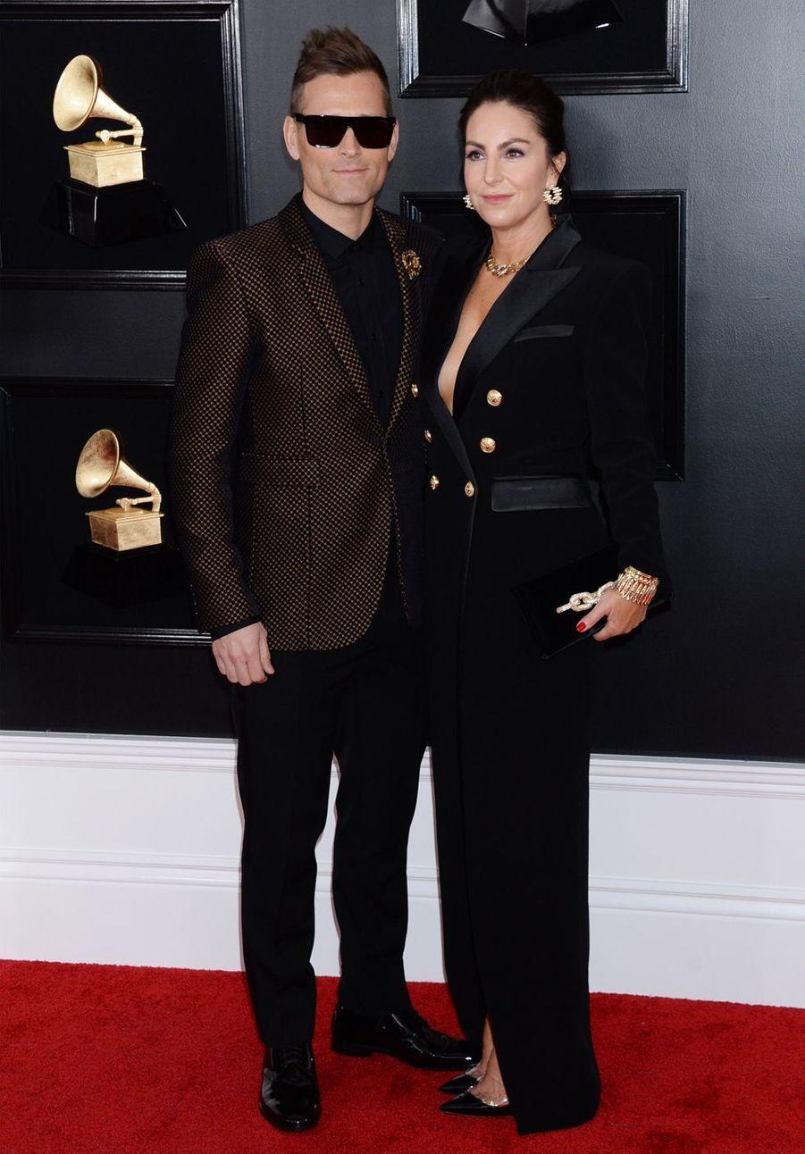 Le DJ Kaskade et son épouse Naomisur le tapis rouge des Grammy Awards à Los Angeles le 9 février 2019