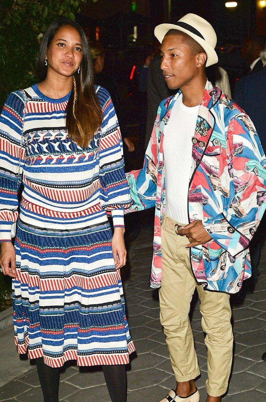 Helen Lasichanh enceinte avec Pharrell Williams en septembre 2016.