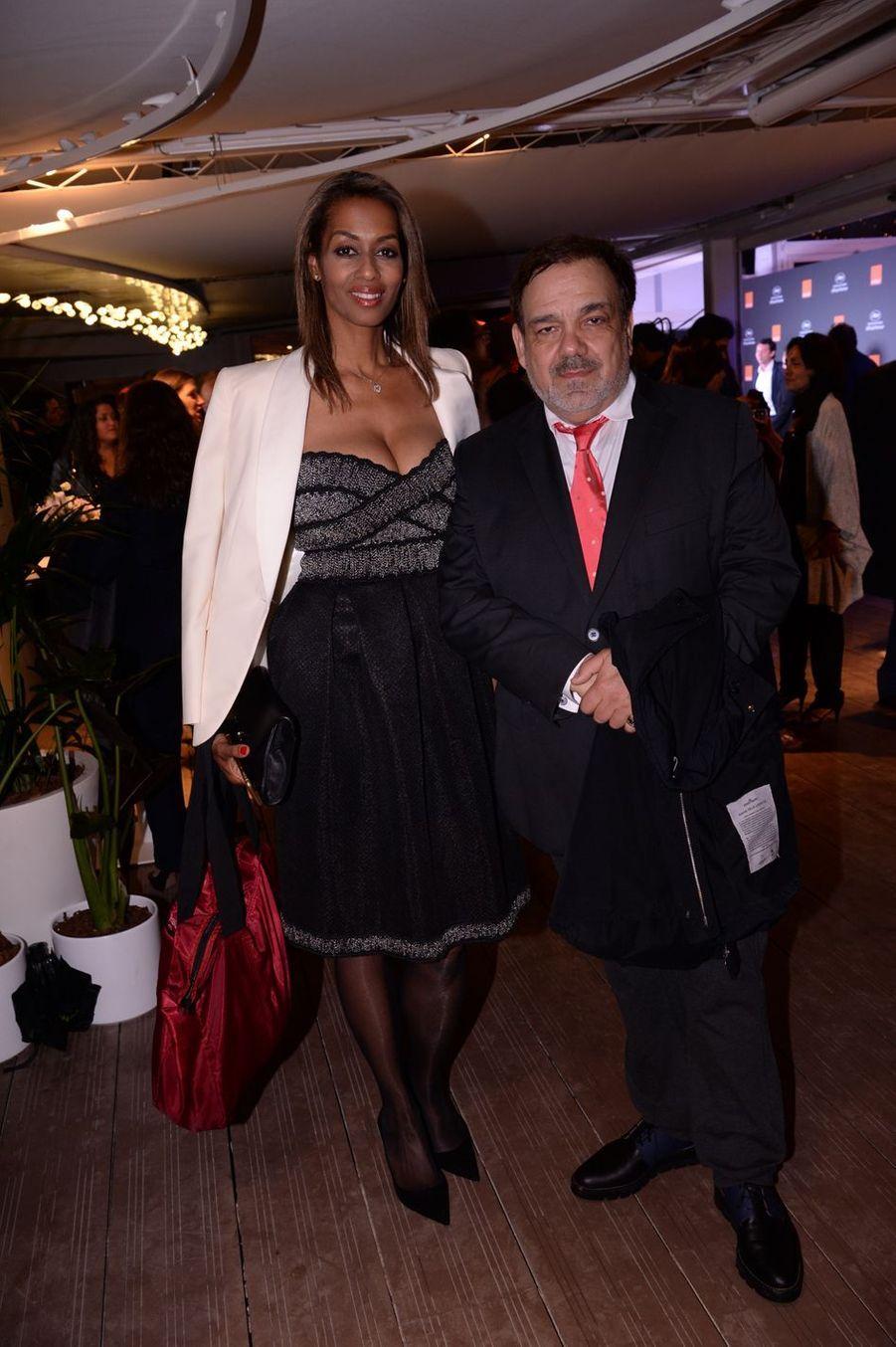 Didier Bourdon et sa femme Marie-Sandra Badinilors de la soirée Orange à Cannes, le 18 mai 2019