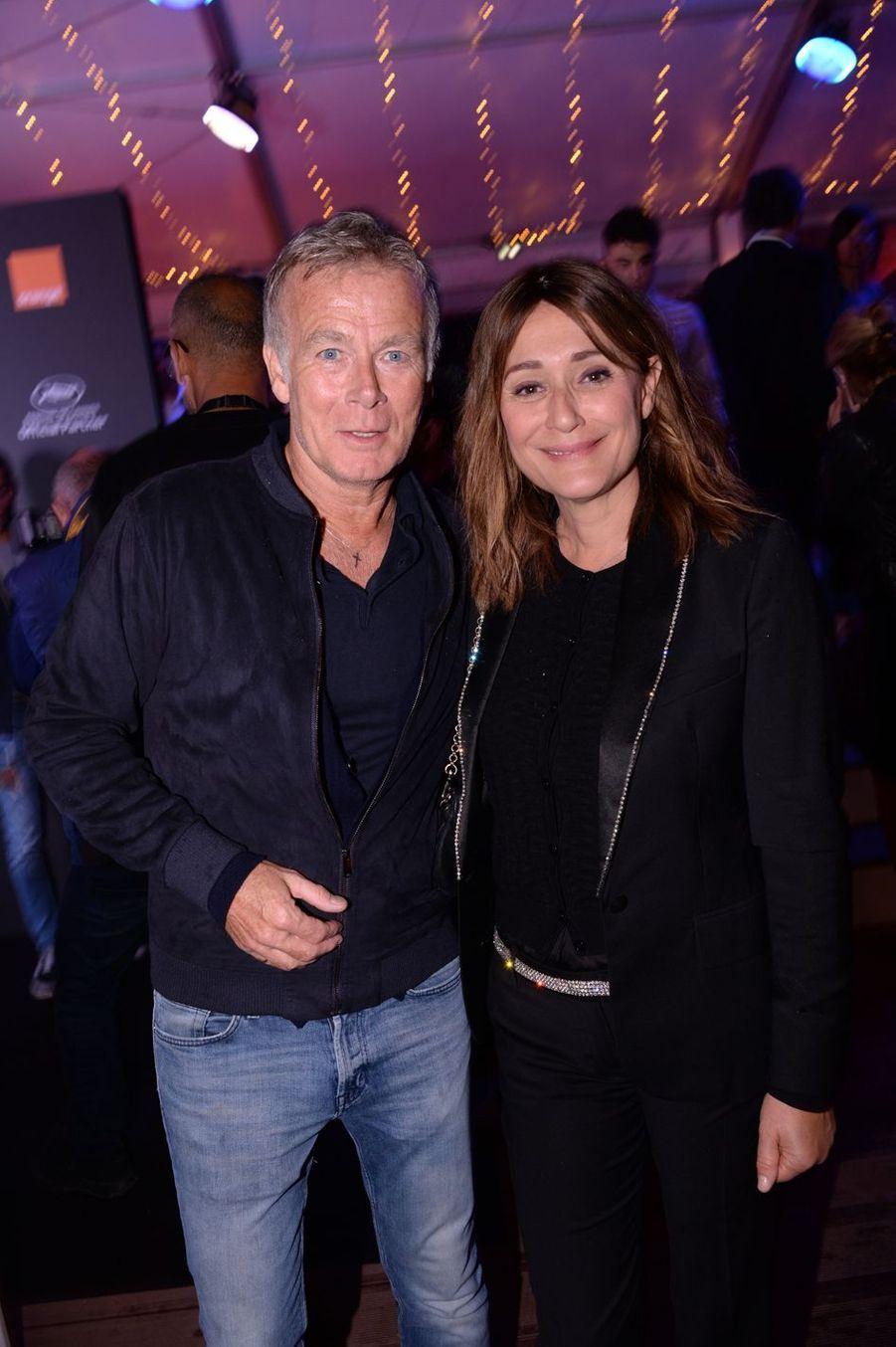 Franck Dubosc et Daniela Lumbrosolors de la soirée Orange à Cannes, le 18 mai 2019