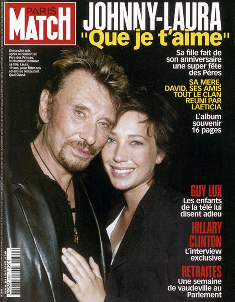 Johnny Hallyday et sa fille Laura en couverture de Paris Match