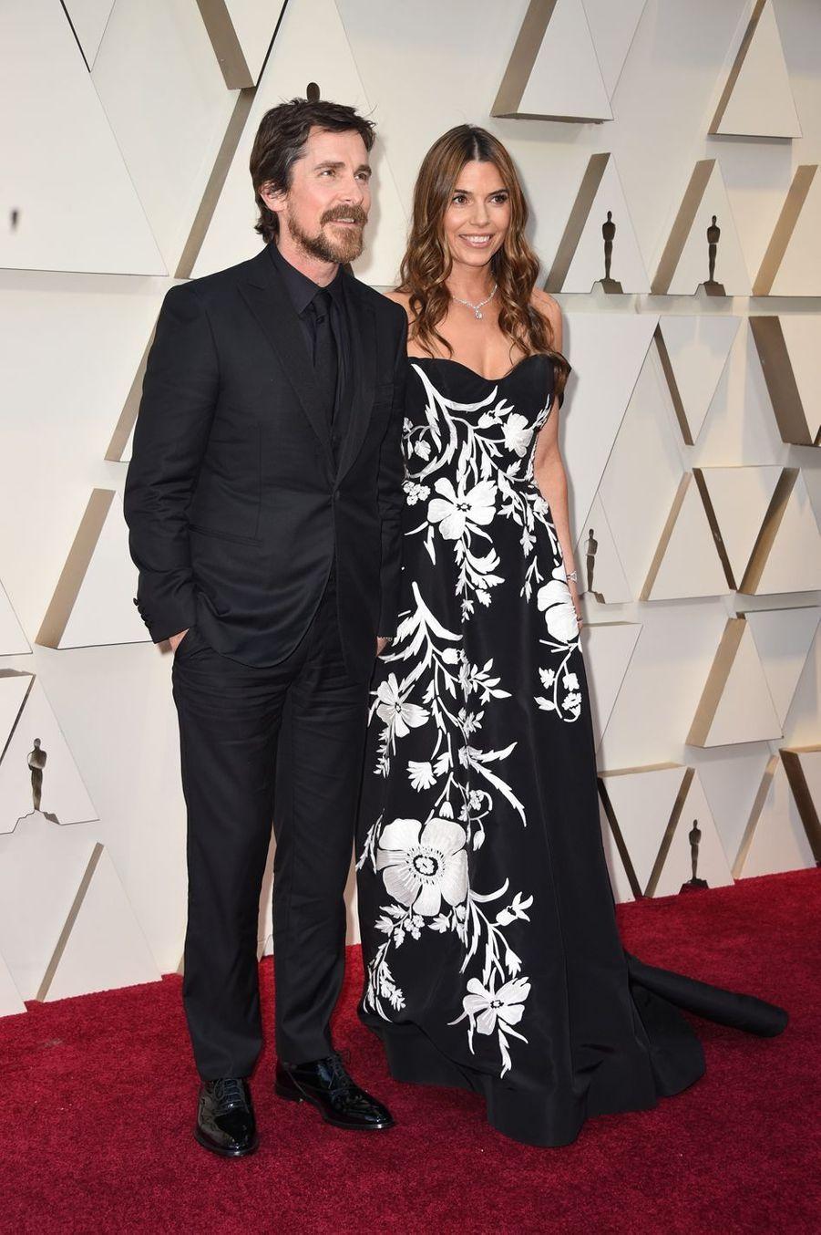 Christian Bale et Siibi Blazicsur le tapis rouge de la 91e cérémonie des Oscars le 24 février 2019