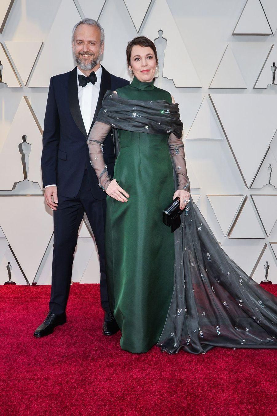 Ed Sinclair et Olivia Colmansur le tapis rouge de la 91e cérémonie des Oscars le 24 février 2019
