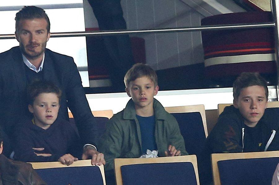 Cruz, Romeo et Brooklyn Beckham avec leur père David Beckham en mai 2013