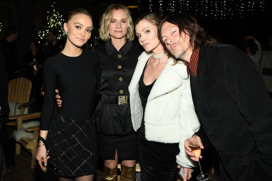 Lily-Rose Depp, Diane Kruger et son compagnon Norman Reedus lors de la soirée organisée par Chanel à New York le 10 décembre 2019.
