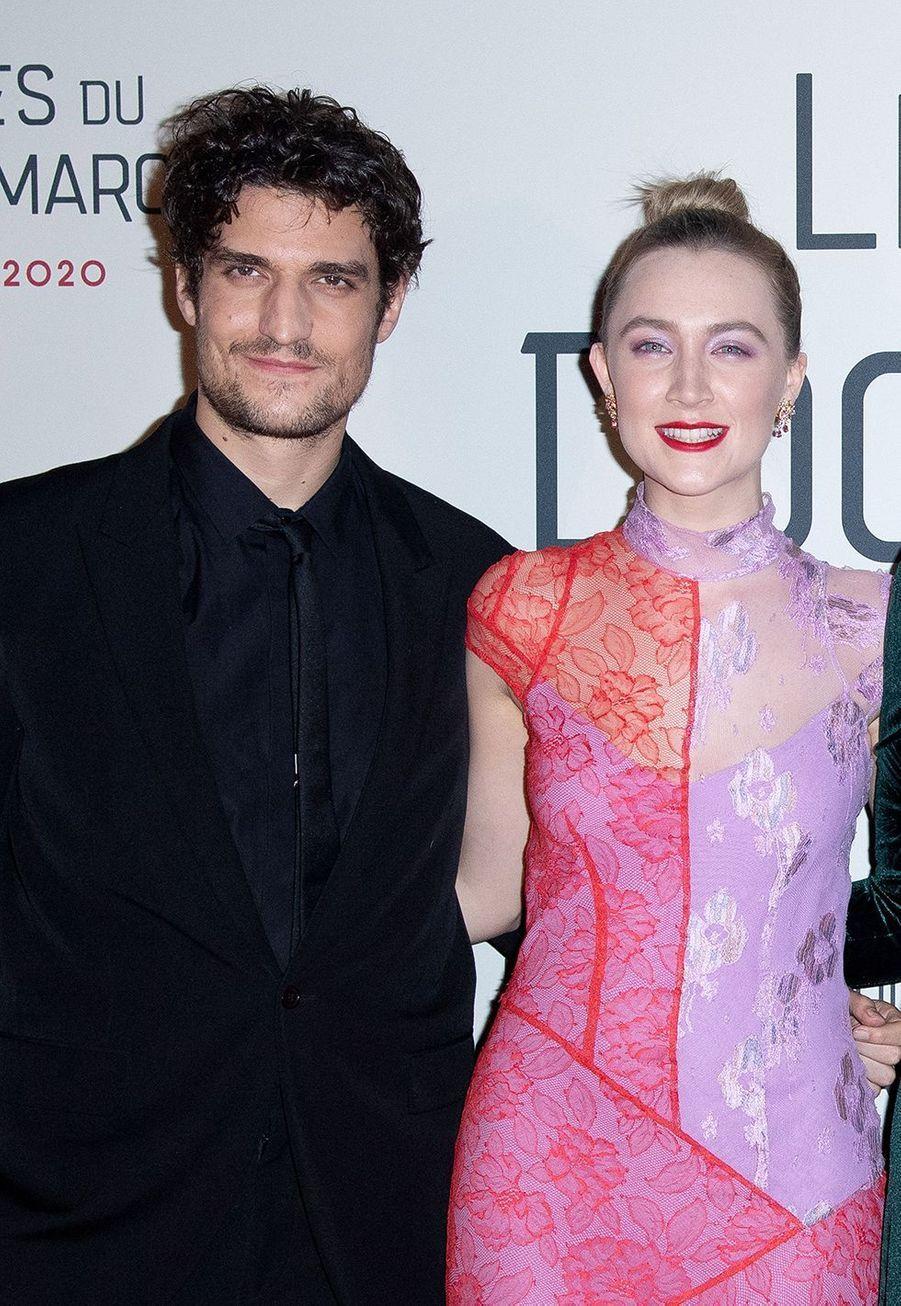 """Louis Garrel et Saoirse Ronan lors dela première du film """"Les filles du Docteur March"""" à Paris, le 12 décembre 2019."""