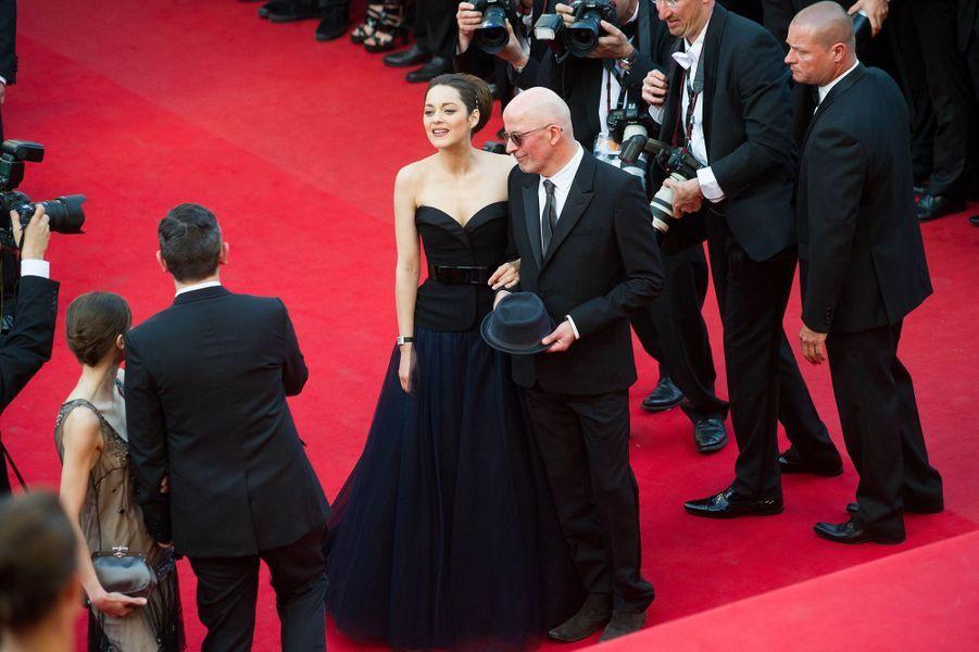 """Marion Cotillard présente """"De Rouille et d'Os"""" avec le réalisateur Jacques Audiard, 2012."""