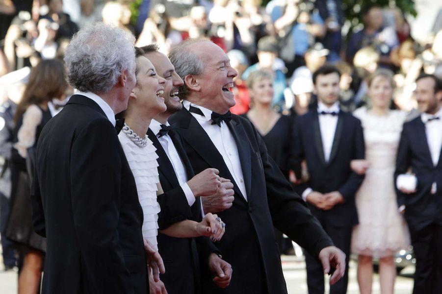 Marion Cotillard entourée des frères Dardenne, 2014.