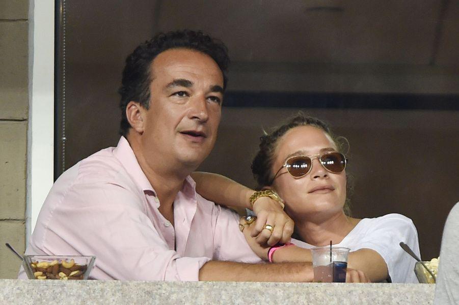 Mary-Kate Olsen et Olivier Sarkozy lors de l'US open à New York en septembre 2014