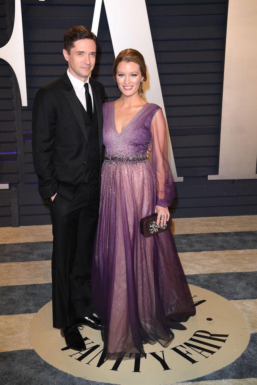 Topher Grace et Ashley Hinshawà l'after-party des Oscars à Los Angeles le 24 février 2019