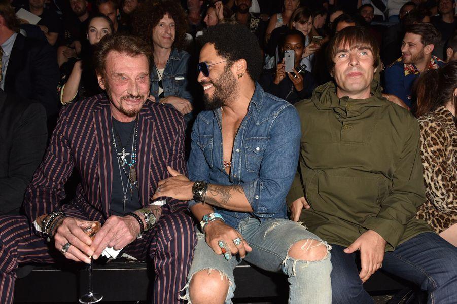 Johnny Hallyday, Lenny Kravitz et Liam Gallagher au défilé Saint Laurent à Paris