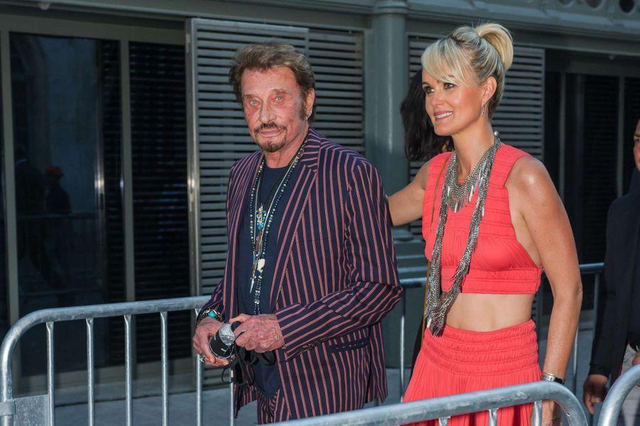 Laeticia et Johnny Hallyday au défilé Saint Laurent à Paris