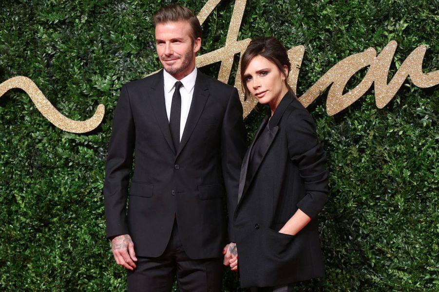 David (en Burberry) et Victoria Beckham (en Victoria Beckham)