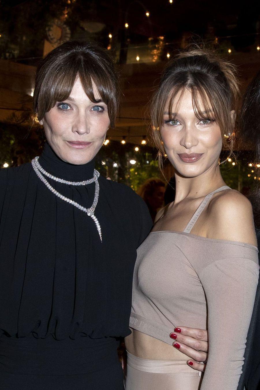 Carla Bruni et Bella Hadidà la soirée organisée par Dior et «Vogue» au restaurantFred l'écaillerlors du 72e Festival de Cannes le 15 mai 2019