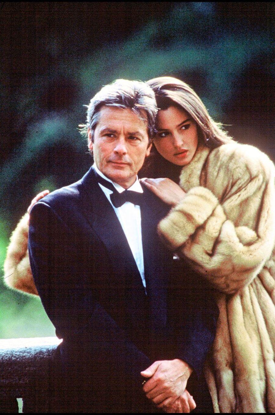 Monica Bellucci et Alain Delon en 1989